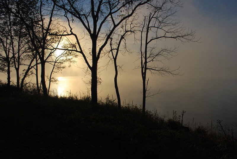 Clear blue foggy sunrise over the lake at Deer Creek State Park. Located in central Ohio