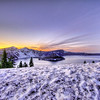 Large snowdrift at Crater Lake at sunset