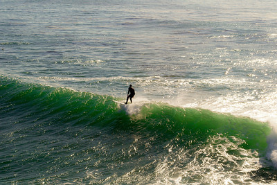 surfer on green waves