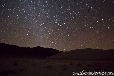 Milky Way Galaxy, some passing airplanes, the Last Chance Range and Eureka Dunes, taken with a 77-second exposure.