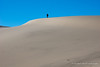 Ryan sets off up the big dune, temperature 29 degrees.