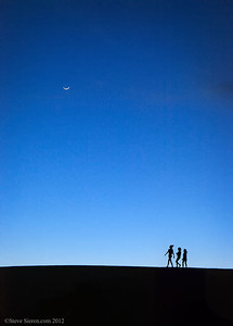 Dune walkers at twilight on the Mesquite Dunes in Death Valley.