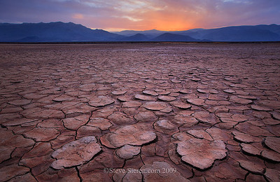 """Infinite View"" sunset on the playa in Death Valley  Death Valley is known for it's vast wide open and expansive landscape scenery.  When you step  onto a playa here it becomes an infinite view."