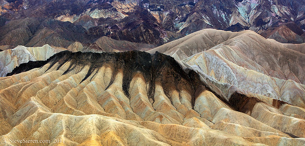 Rainy Day - Zabriskie Point Endless colorful badlands in Death Valley during a rain storm create a muted yet colorful landscape.