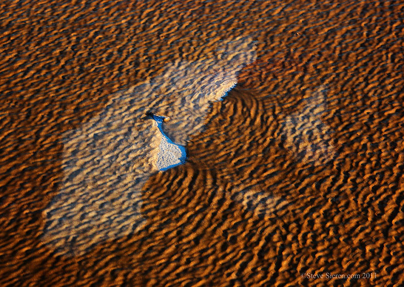 Death Valley abstract of winding pushing water across dry desert land