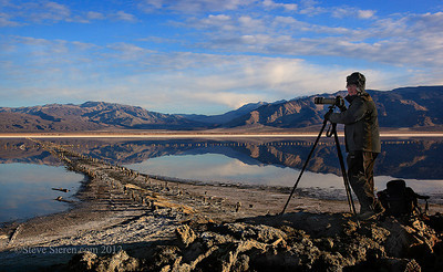 Photographer in a salt lake in Death Valley 2012