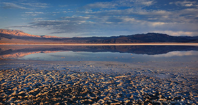 Dry lake reflection panorama in Western Death Valley, California.