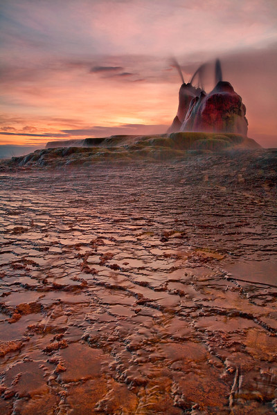 An amazing sunrise sheds light on the erie fly geyser.  THis man-made location looks like something out of a Ridley scott movie.
