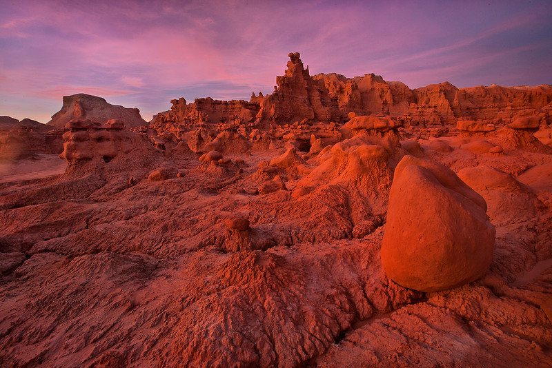 A warm sunset on the interesting shapes of Goblin Valley, Utah