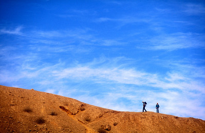 Hikers in the area of the great crater, Negev desert, israel