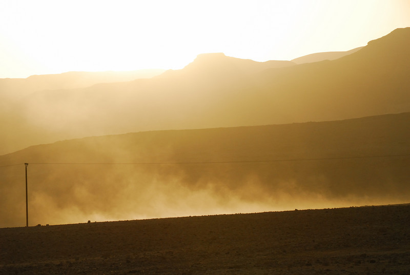 The hot afternoon wind kicks up some dust in the desert near the Dead Sea and Mt. Sedom, Israel.