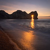 Sunrise through Durdle Door