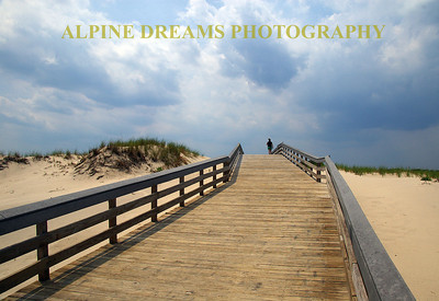 Boardwalk  over the dunes at Island Beach State park.   Storm is coming from the Bay side. The sun was hanging in there for now.