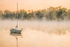 Sailboat in morning fog on the Richelieu river