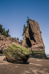 Hopewell Rocks - the Bay of Fundy is one of the natural wonders of the world as the tides can rise and fall as much as 50 feet every day twice a day. One of it's most famous landmarks is Hopewell Cape with it's 'flowerpot' rocks which are constantly changing. Just 3 hours after this shot, the tide rose up to the green algae line.