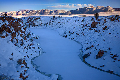 Snowy Owens River and Glass Mountains in winter.