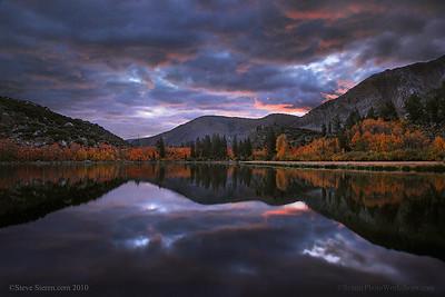 Fall colored aspens surround a high lake in Eastern Sierra