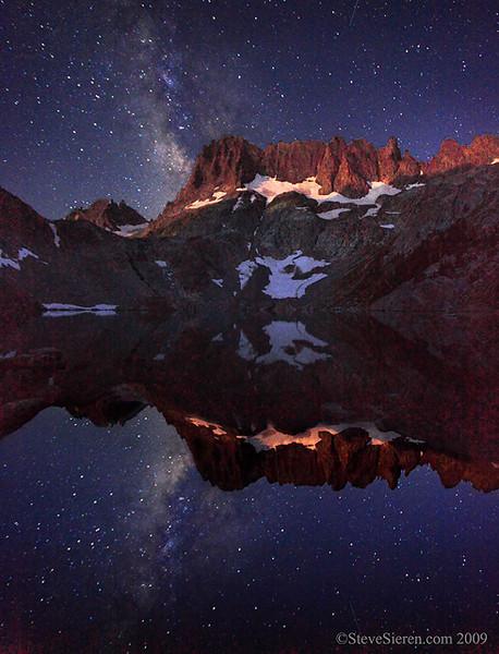 The Milky Way and alpen moon glow on the Minarets in the Ansel Adams Wilderness, Eastern Sierra.