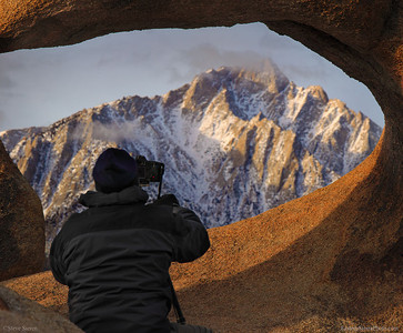 Photographer framed by Mobius Arch in the Alabama Hills, Eastern Sierra Nevada Mountains.