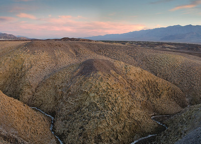 Having gathered at the airport in Las Vegas, we arrived in Death Valley late in the day. Our intended destination was too far, and the sun was setting, so we pulled off and shot the sunset in roadside badlands. The car thermometer showed 119 degrees and the wind was blowing.