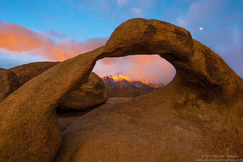 Mt Whitney shinning at sunrise as seen mobius arch, Alabama hills
