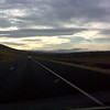Between Richland and Prosser on I-82.  The clouds, the light, and the hills in the distance struck me.