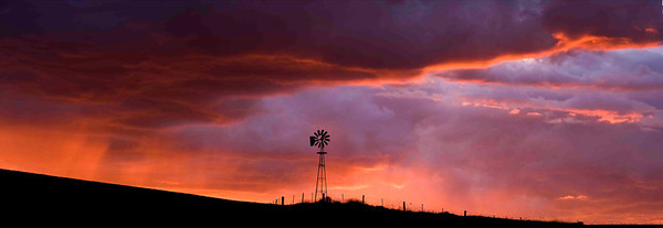 """Prairie Sentinel"" Near the town of Colfax in Eastern Washington, an old windmill is silhouetted by a chaotic sky and a fabulous sunset."