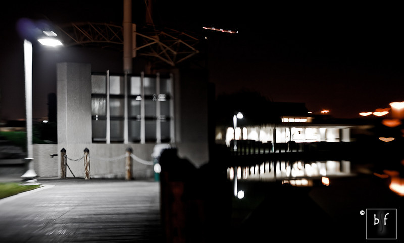 """The Lensbaby made the recreation center on the right appear progressively out of focus. The """"sweet spot"""" is under the street light on the left. Too bad there wasn't a person standing there. More heart shapes on the far right! :-)"""