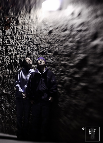 """With my camera on a tripod, I set up a 10-second delay to take this photo. I told Shalimar to look up at the light so that our faces were illuminated, but I was caught peeking at the camera. :-) I'm wearing my Vikings beanie. Go Vikings!<br /> <br /> After taking this photo, we quickly went back to the car to get out of the cold night. Shalimar said """"No more creative photos!"""" :-)"""