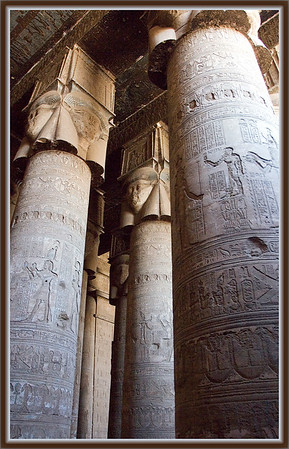 Temple of Hathor....Dendara, Egypt<br /> Columns feature Hathor in her human guise with cow ears at the tops of these columns.