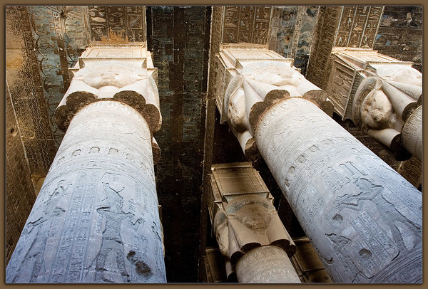 Temple of Hathor....Dendara, Egypt<br /> There are only so many ways to indicate how unique this place really is. The scale of the colums, the delicacy of the carvings and reliefs, the sheer amount of it, and here a bit of how much color still remains in the ceiling work after all the years. The glory that must have been here before the ravages of time and man!!
