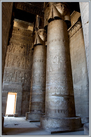 Temple of Hathor...Dendara, Egypt<br /> Hathor, goddess of pleasure and love, is shown in her human form with cow's ears at the top of the 18 columns of the hypostyle hall of this temple. The detailed reliefs on the columns and walls form an endless and magical tapestry of intricate textures.