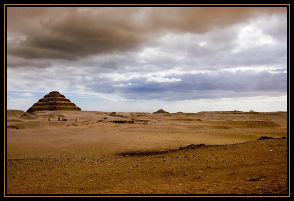 The Step Pyramid of Pharoah Djoser (Horus Netjerikhet c.2667-2648BC)as viewed from a slightly north-west position. Designed by the architect, Imhotep, this is the first pyramid in Egypt and the earliest large stone structure in the world! Arising from vast and undulating desert sands, this structure commands attention with its imposing, timeless presence..........Saqqara, Egypt