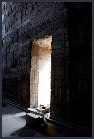 Temple of Hathor...Dendara,Egypt<br /> Sunlit window showing the detail is carried along all surfaces of the building.