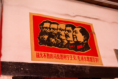 "(CH-10120)  ""Heros"" of Communism at a coffee shop in Pingyao."
