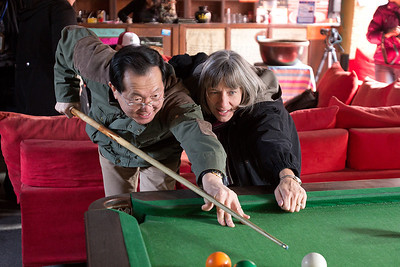 (CH-10125)  Kathy gives HeGang billiards lessons.
