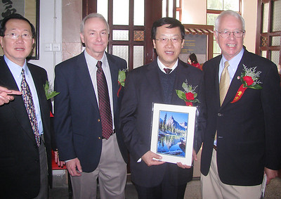 A gift (Lone Eagle Peak and Mirror Lake) is presented to one of the Chinese officials.