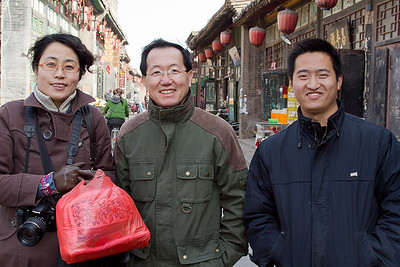 (CH-10159)  Li, HeGang, and Pingyao tour guide.