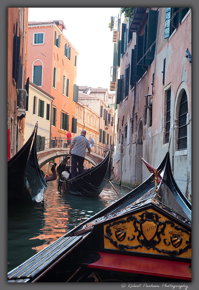 (VE-04)  Gondola ride through the canals of Venice.