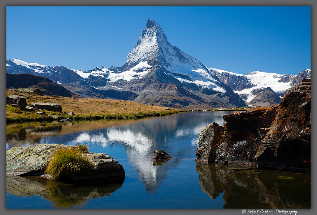 (SW-12108)  The Matterhorn reflected in Stellisee Lake high above Zermatt, Switzerland.