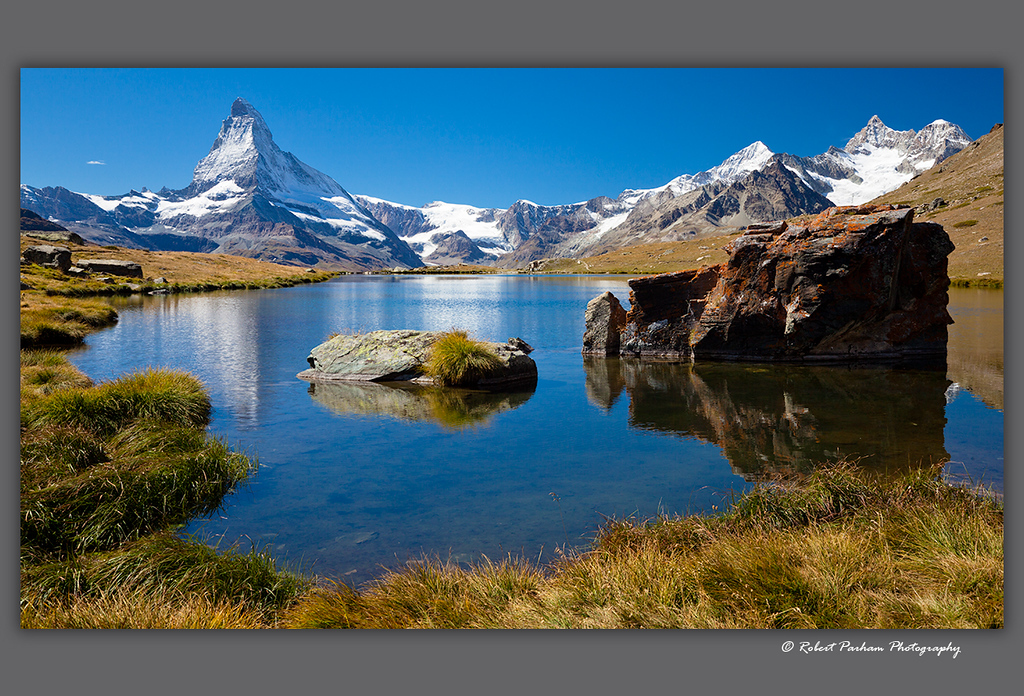 (SW-12112)  The Matterhorn and Ober Gabelhorn (upper right) viewed from Stellisee Lake above Zermatt, Switzerland.