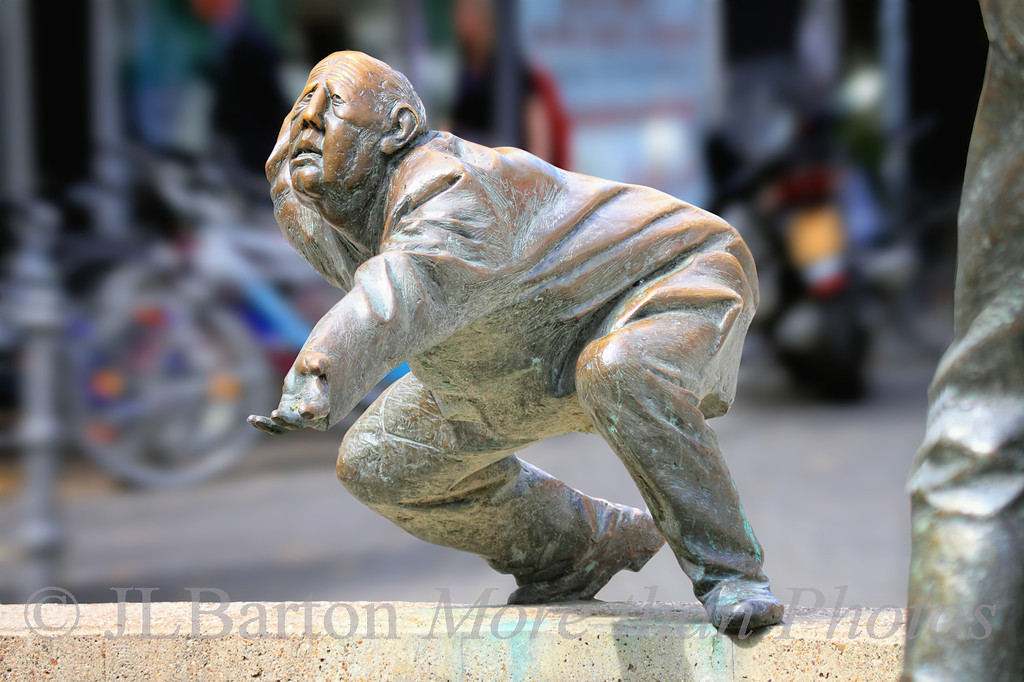 """Begging - one of the figures of a sculpture """"Der Kreislauf des Geldes"""" [The circulation of money] at a fountain in downtown Aachen (Aix la Chapelle), Germany.  Thanks to all of you who have found my pictures in the last week or so.  Your comments are highly appreciated."""