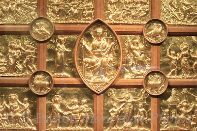 "The Pala d'Oro in Aachen (Aix la Chapelle) 2011-08-09  Created around the year 1000, it decorates the front of the altar in the Aachen cathedral.  In the middle is Christ.  The twelve panels tell his story from entering Jerusalem to the women finding the empty grave.  The four circles hold the symbols of the four evangelists.  Many many thanks for your numerous and excellent comments on yesterday's ""beggar"" sculpture.  Very very appreciated.  Thanks.  A great community."