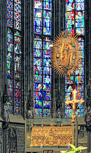 The high chancel, in the gothic addition.  Over 1000 square meters of stained glass windows, often replaced - the last time after the end of the second world war.  The case holds the holy reliquaries, opened once every seven years.