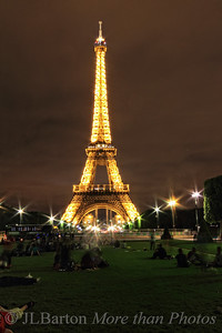 Guess where I am! 2012-06-29  Actually I've been here all week, but sitting in meetings all day long.  This shot was taken approx. midnight - isn't it wonderful that pairs are resting on the grass.  The Eiffel Tower was actually sparkling - which can't be captured in a 30 second exposure. There are very few such iconic constructions in the world.