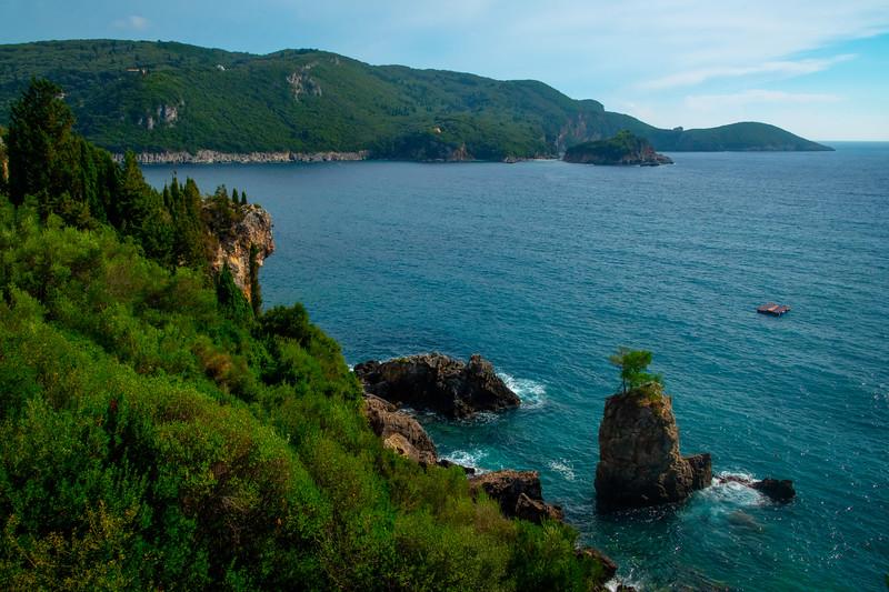 The Rocky Shoreline Of Corfu's Coastline - Corfu, Greece