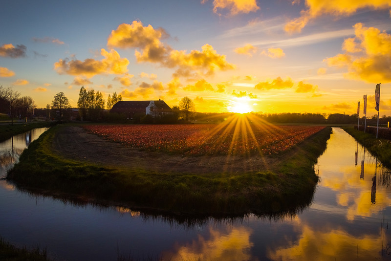 Sunset Touches Down On Farm Field and Waterway