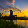 Sunburst Silhouette On The Windmills