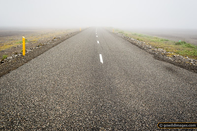 Road 1 fades into the fog