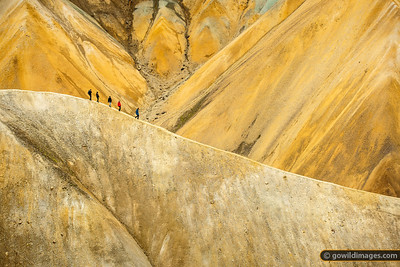 Walkers on an exposed ridge of Brennisteinsalda, Landmannalaugar